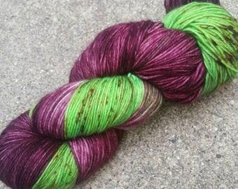 The Sensational She-hulk 4 ply sock yarn - 75/25 SW Merino/Nylon - Wine/Green/Brown Speckles