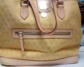 Dooney and Burke pale yellow handbag