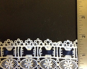 2 yds of white lace with satin ribbon insert