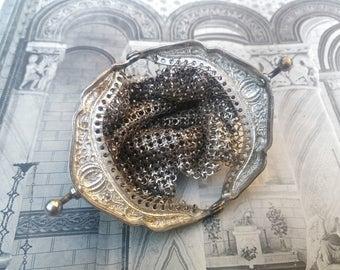 Vintage silver mesh coin purse .