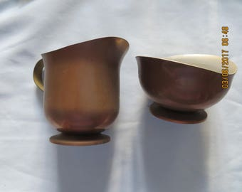 vintage copper aluminum creamer and sugar