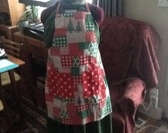 A vintage Christmas bib apron, handmade with two huge pockets in the front, cooking at Christmas, New Years, and after is a messy job .