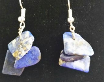Polished rough lapis lazuli dangles in silver