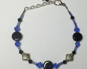 Ladies beaded black onxy, blue crystal and silver adjustable bracelet, handmade