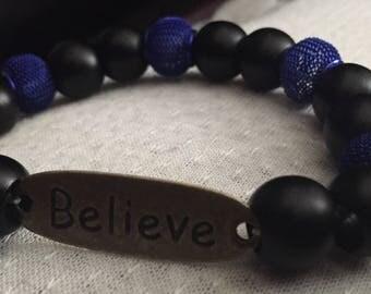 Mens blue and black bead believe bracelet