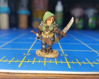 Bailey Silverbell, female dwarf miniature. Hand painted for your tabletop dungeons and dragons game.