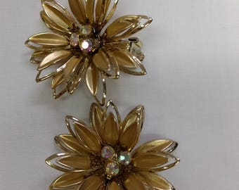 Gold tone flower pin and matching clip earrings