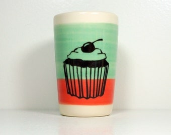 itty bitty cylinder / vase / cup with a cupcake print on a colour block of Blue Green & Red Orange, Ready to Ship.