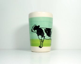 itty bitty cylinder / vase / cup with a Holstein Cow print on a colour block of Blue Green & Leaf Green, Ready to Ship