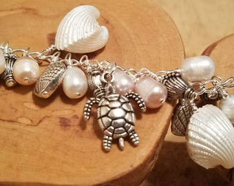 Beach Turtle chunky cha cha bracelet chock full of pearls shells and more ... and it's adjustable too!
