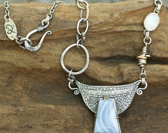 White agate pendant necklace with silver details and lightly oxidized silver chain