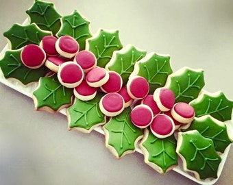 Decorated Holiday Christmas themed sugar cookies for company, cocktail, family parties. Holly, berries, leaves