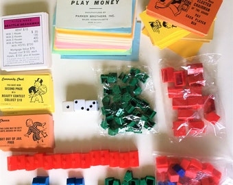 Monopoly cards money houses hotel red blue Star War Seattle community chest white dice sealed bag green chance cards game destash art
