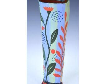 Tall flower bucket, bud vase. Vine with flower.