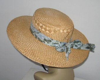 straw hat . wide rimmed straw hat .