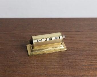 Antique brass desk calendar