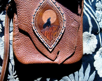 Wolf Song simple cowhide leather bag with tooled wolf design