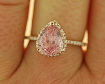 Peach champagne sapphire engagement ring. Rose gold engagement ring 2.87ct pear cut sapphire diamond ring. Engagement ring by Eidelprecious