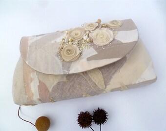 Monochromatic clutch, fiber art purse, beige fiber collage, embroidered, featured in Haute Handbags Spring 2017 issue