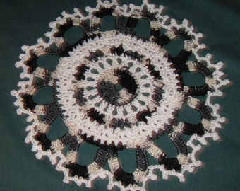 "Black and white doily, 9"" across"