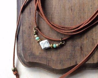 CHOKER brass, beads and deerskin suede