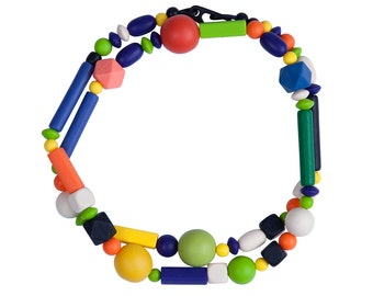 Long geometric rubber and resin bead necklace, designer jewelry by Frank Ideas