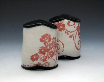 Red and Black and White Salt and Pepper Shakers with Flower and Spiral Pattern