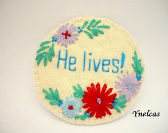 Textile brooch hand embroidered with inspirational love words - HE LIVES!  brooch