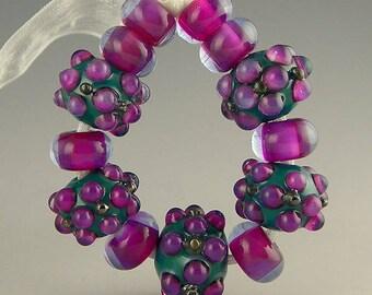 handmade lampwork glass bead set of 13 bright beads in green and purple  - Lush Plum