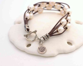 Leather and Pearl Bracelet. Multistrand Freshwater Pearl and Brown Leather Bracelet with Toggle Clasp and Lotus Flower Charm.