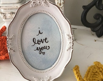 Hand-lettered framed quote: I love you