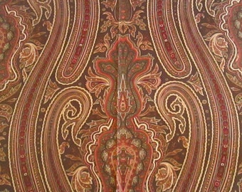 "A 25""-square Ralph Lauren Home decorator sample of a paisley pattern in red, olive and gold"