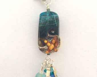 Changeable pendant with large ocean lampwork bead.