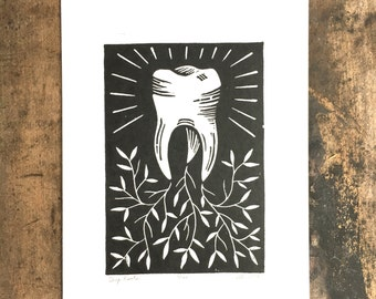 Deep Roots   Linoleum print of tooth on paper