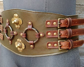 Primitive Tribal Olive Green Leather Wide Belt w Ethiopian Shields, Antiqued Brass Rings and Antiqued Brass Hardware