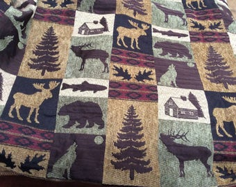 Chenille wildlife tapestry fabric. 1 yard by 56 wide