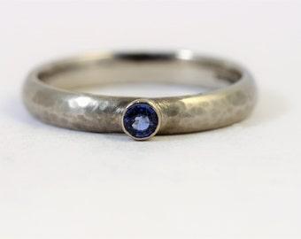 Hammered 3mm wide palladium ring with 2.9mm round Blue sapphire.