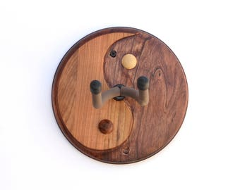 Guitar wall hanger handcrafted in hardwood with Yin Yang design