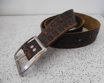 geometric...vintage tooled leather belt with silver buckle