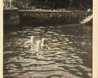 Vintage Photo of Teenagers or Young Adults Swimming in a Pool