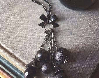 Black Gunmetal beaded tassel & Bow charm necklace