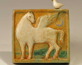 White Pegasus plaque with bird and blue Moon