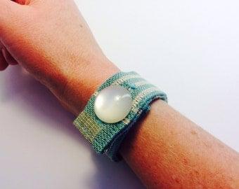 Fabric cuff with button closure