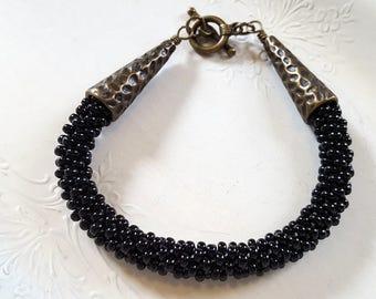 Black Bead Stitched Bracelet Brass Tone Cone Caps Toggle Clasp