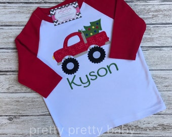 pretty festive monster truck with Christmas tree shirt