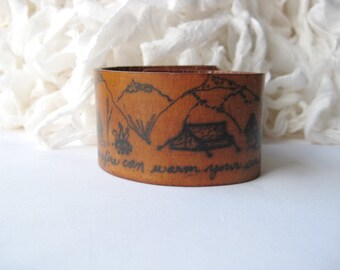 A campfire can warm your soul - Wide Leather Bracelet - Hand scripted quote ink doodle mountains, trees, tent and campfire - hiker gift