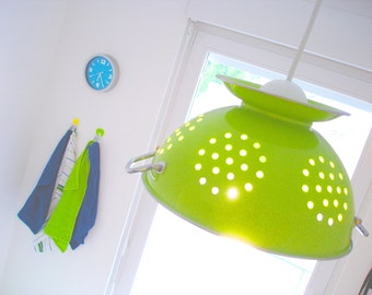 Anise green design lamp realised with a metal sieve
