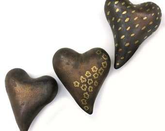Bronze heart, porcelain in metallic glaze, with gold