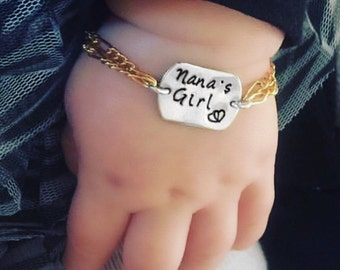 Gold filled and silver adjustable infant to toddler baby bracelet. Custom stamped with name, date etc..