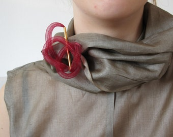 Contemporary cool brooch, gold plated brass,  and plastic tube.
